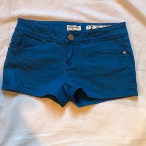 Indigo Rein, blue shorts